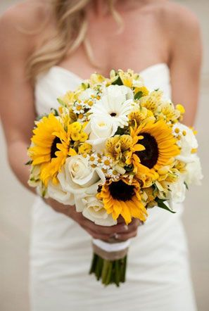 sunflower wedding bouquet with white gerbera daisies and white roses More
