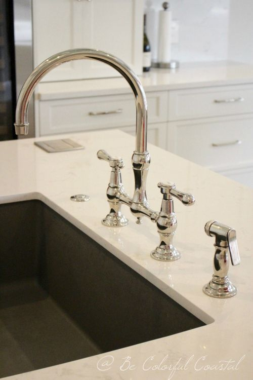 Newport Brass Chesterfield Bridge Faucet in an all white coastal kitchen with Cambria Torquay countertops and Blanco sink in metallic gray. @becolorfulcoastal.com http://www.becolorfulcoastal.com/2017/02/a-coastal-kitchen-reveal.html