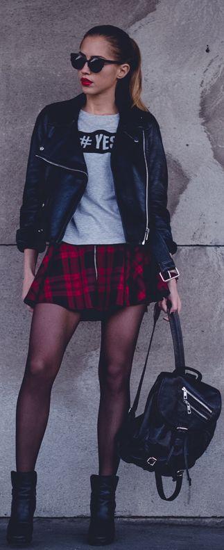 Black biker jacket, grey tee-shirt and tartan mini skirt