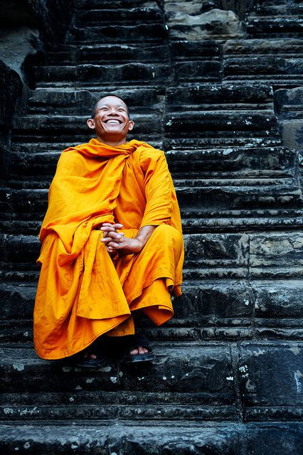 A Buddhist Monk at Angkor Wat. Photo by Jon Bauer #Cambodia #Traditional #AngkorWat - curated by @ethicalfashion1
