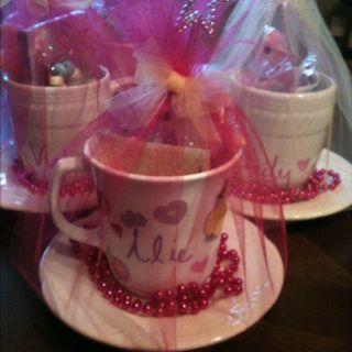Princess tea party favors for guests.  Just add a few princess favors and wrap around with tulle!  Quick and easy!!