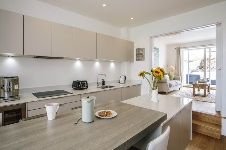 The modern kitchen at 1 The Sands, our self-catering holiday cottage in Polzeath, North Cornwall. Here you have everything you need to enjoy and prepare meals with friends and family.