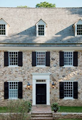 Love, love, love--formal balance, stone walls, dormer and transom windows...gorgeous architecture