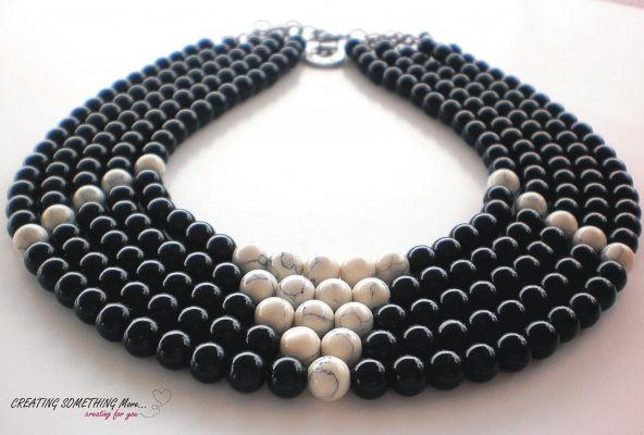 "Beads Necklace White- Κολιέ με 5 σειρές από μαύρη χάντρα και λευκή με νερά στο χρώμα του μαύρου. Στο τελείωμα στοιχείο "" Made in Greece ""  | myartshop"