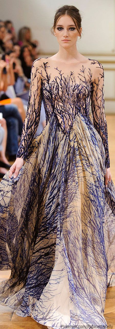 The models should not be so bleak, wearing an enchanted dress like this. they should be mysterious, shadowy, elusive, radiant like moonlight shafting through winter branches. I would try to be like that if I wore a dress like that.