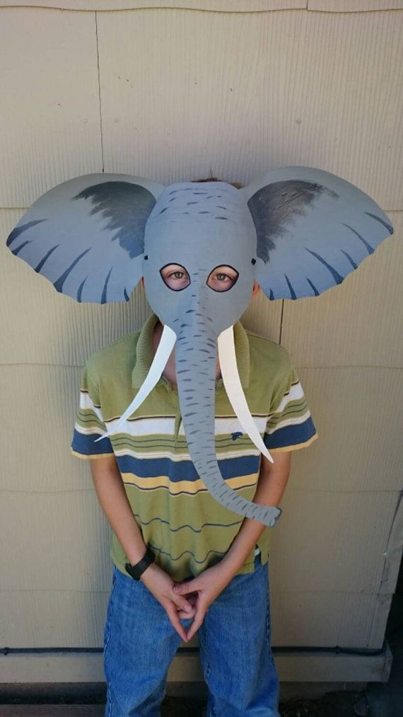 Paper mache elephants masks held on securely with black elastic. These were specially ordered in brown, but I can certainly do the more