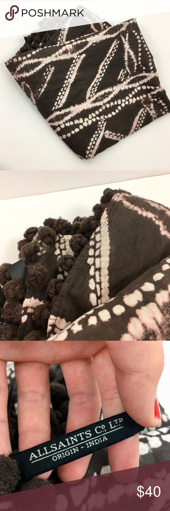 All Saints Brown Pom Pom Bandini Scarf Brown cotton scarf with a pale pink print. 100% cotton printed large scarf with tonal pom pom tassles on each side. The print has been inspired by traditional hand dyed bandini patterns. Size 210cm x 100cm. 100% Cotton. EUC - no signs of wear. All Saints Accessories Scarves & Wraps