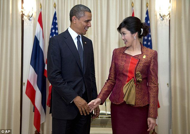 President Obama shakes hands with Thai Prime Minister Yingluck Shinawatra as he arrives at the Government House in Bangkok, Thailand