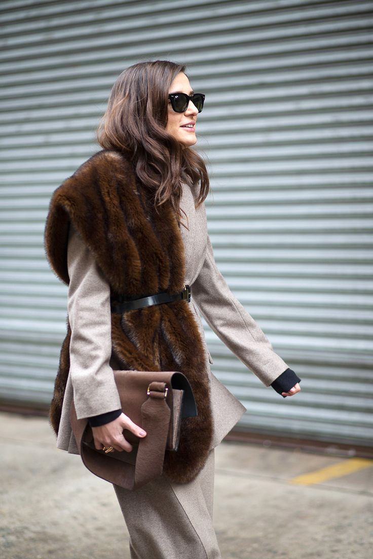 Stoles were draped across the body pageant style at Jason Wu, Thakoon and Michael Kors, proving to be a major trend for NYFW. This glossy-haired showgoer demonstrates the chicest way to style a fur scarf—cinched with a skinny belt. Get her hair hue: Vidal Sassoon Salonist 3/0 Darkest Neutral Brown - HarpersBAZAAR.com @sommerswim
