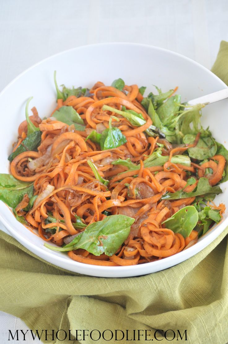 Balsamic Sweet Potato Pasta with Caramelized Onions and Greens. This is SO GOOD.  A healthy recipe that is gluten free, vegan and paleo. Make it in under 30 minutes.