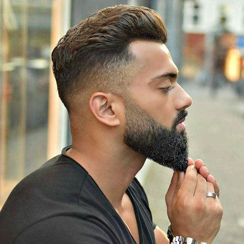 undercut hairstyle with tapered beard