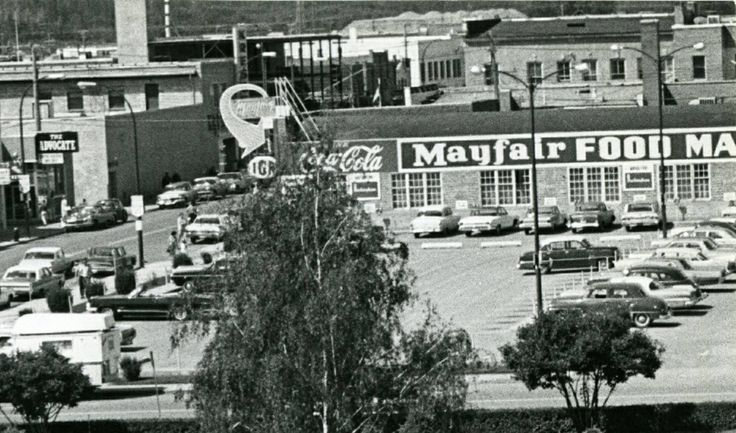 The Mayfair IGA store on 49 St, west of 49 Ave. This later became the Uptown Theatre, 1960 Red Deer, AB