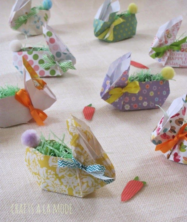 Origami bunny boxes would make great table seating labels. She has a link to the video that shows you how to make them. I think her version is cuter than the original with the scrapbooking paper, pom pom tail and ribbon.