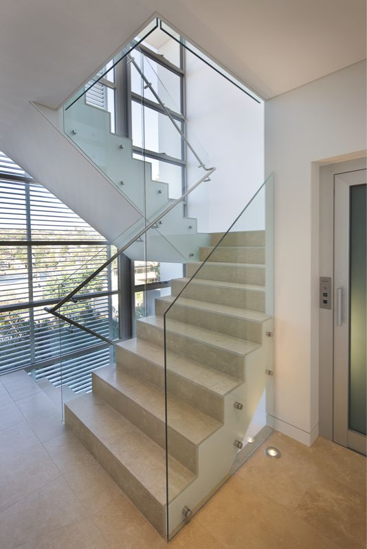 See what's possible with glass bannister rails - presenting the Dorset Road House: http://www.corben.com.au/index.cfm?id=129