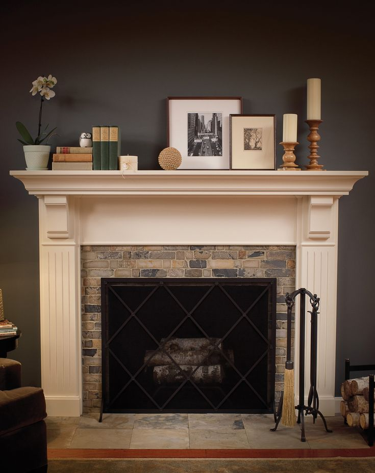 "Create a Personalized Fireplace Mantle with Dura Supreme: Select your own frieze, finish, corbels and column styles from our large array of options to create a truly personalized Fireplace to be the focal point of your home. Dura Supreme Fireplace Mantel ""A"" shown with ""Antique White"" paint on a Navy Blue painted wall. Transitional Styling, Frieze ""A"" and Column ""A"". – Find more ideas like this at DuraSupreme.com   #DuraSupreme #interiors  #fireplaces #madeintheusa #navyblue #mantles"