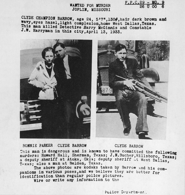 A wanted poster for Bonnie and Clyde used personal photos lawmen found in one of their deserted hideouts. 1933.
