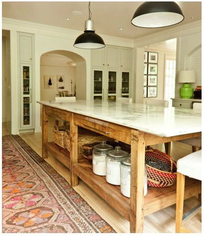 KITCHEN // massive marble-topped island. Not my usual taste but this is cool