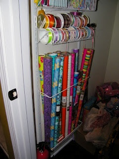 wrapping paper storage - Just got this rack at Target for $35 today! Hung it over the door until I find a permanent placement! No more squished wrapping paper. :o)