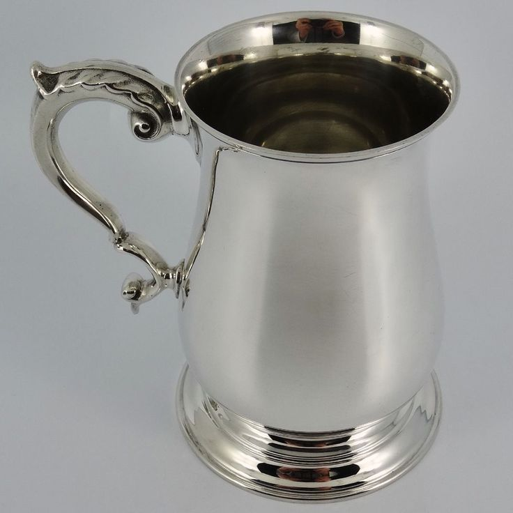 A heavy tankard coming in the Georgian style with a scroll shaped handle. The tankard is of superb quality and a very good gauge of solid silver. A useable tankard which holds one full pint. A solid sterling silver one pint tankard by J B Chatterley & Sons Ltd. | eBay!