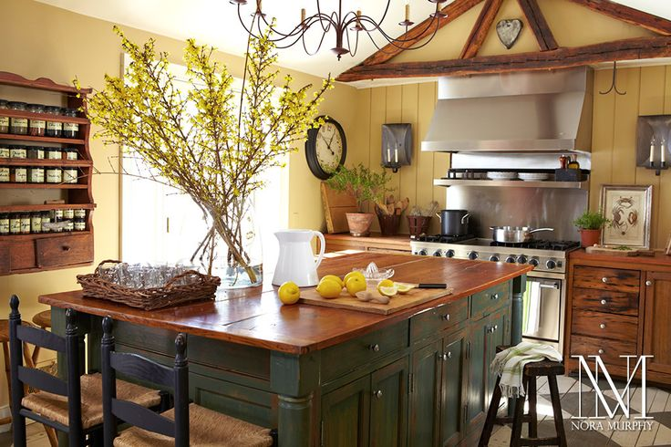 small country kitchen with island seating and storage