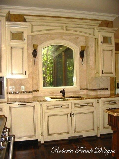 Custom Cabinets, Arched Windows And Fantastic Finishes.