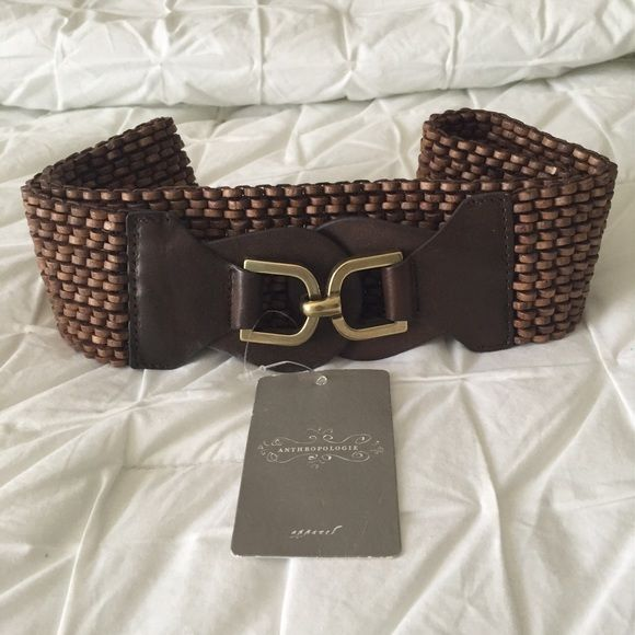 NWT Anthropologie Brown Stretch Belt Anthropologie brown stretch belt with wooden beads and gold hook closure. Approximately 33.5 inches long. Material 45% wood, 20% genuine leather, 25% rubber Anthropologie Accessories Belts
