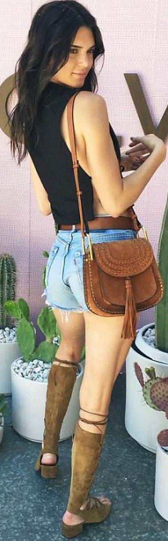 Kendall Jenner: Shorts – Levi's  Purse – Chloe  Shorts – Levi's  Shoes – Saint Laurent  Shirt – Trois