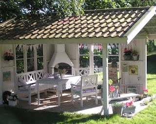 A beautiful idea for an outdoor living space.  It reminds me of those horrid park picnic table shelters, but much more lovely!