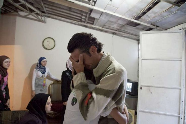 Ahmad is overcome with emotion as he says goodbye to his younger brother, who will not be going to Germany. ©UNHCR/E.Dorfman