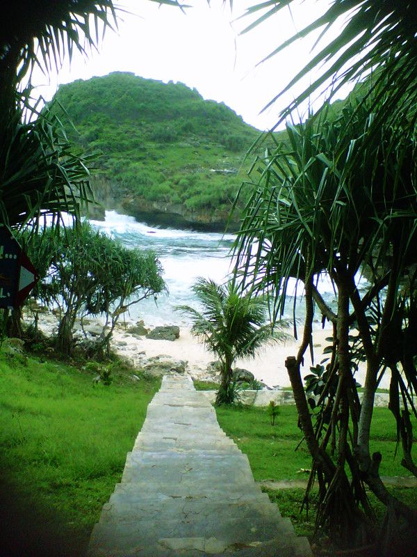 must pass through the steep stairs to reach the beach sumbukan