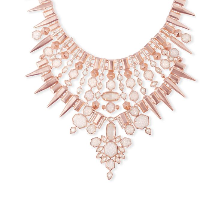 "A statement necklace made for the belle of the ball, this Seraphina Necklace in Rose Gold is equal parts romantically feminine and boldly on-trend. - 14K Rose Gold Plated Over Brass - Size: 4""L bib, 2"