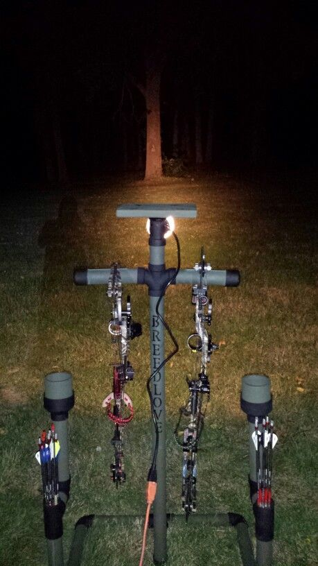 PVC Bow Hanger with a Flood light, cup holder, arrow holder, and table top!