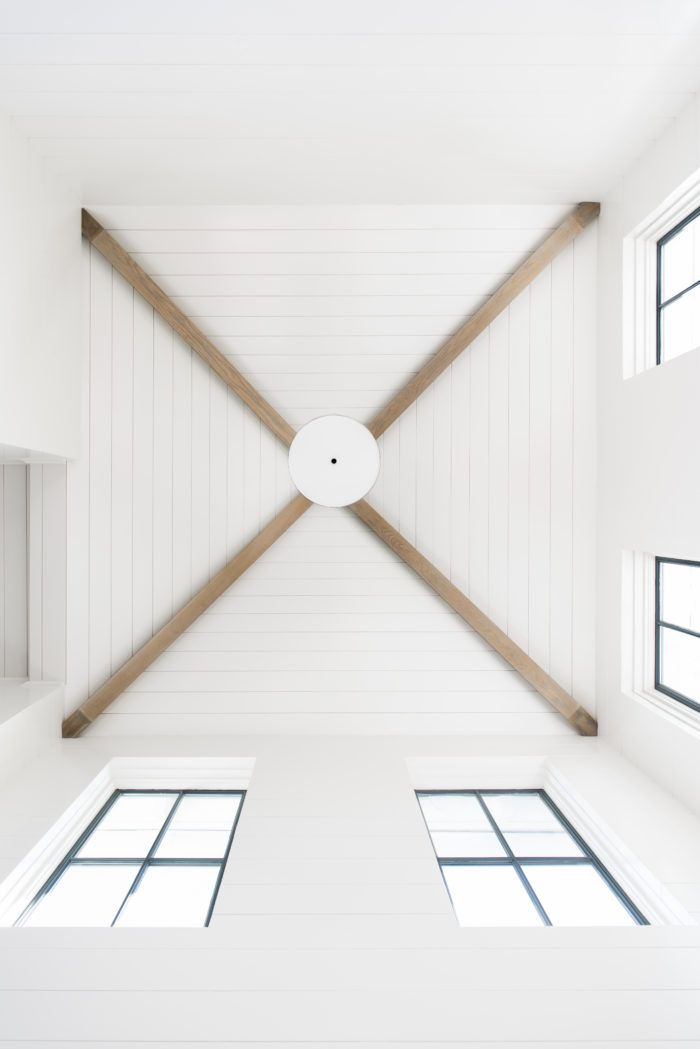 White shiplap ceiling with wood beams | Barrow Building Group