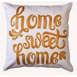"Add a homely touch to your decor with the ""Home Sweet Home"" cushion cover. It is hand crafted with rich Indian Zari art. This cushion cover is ideal for both the bedroom and living room. In fact, it makes a lovely gift for friends as well."