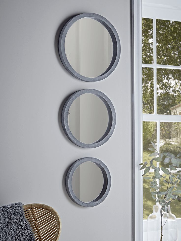 With an industrial inspired rough concrete effect frame and round mirrored surface, our set of three decorative mirrors will add an edge to your interior.  Hang together to make a style statement, and pair with fresh botanicals and natural textiles to soften the look.
