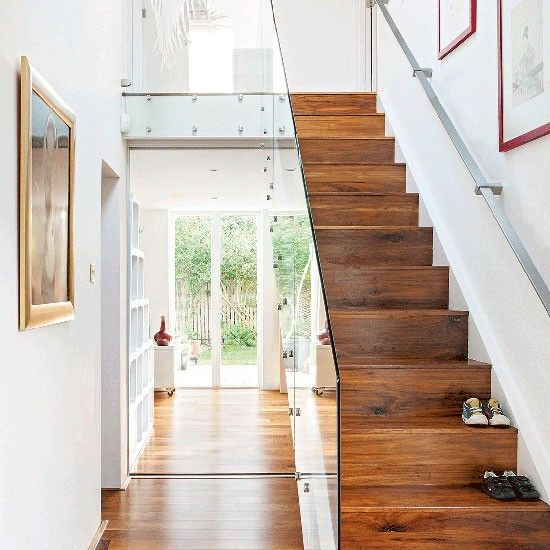 Dark wood hallway with glass banister | Small hallway design ideas | Decorating | housetohome.co.uk