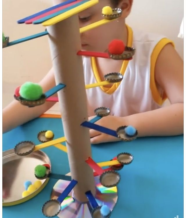 """Home made fine motor toy. Use tweezers to place the pom-poms on the tree """"branches"""""""