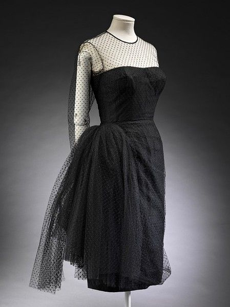 Madame Gres | c. 1965    Cocktail dresses gained a new popularity after the Second world War. They were worn at early evening or '6 to 8' gatherings. Since guests usually stood and mingled the gowns could include complex bustles and skirt details, which would be crushed if sat on.