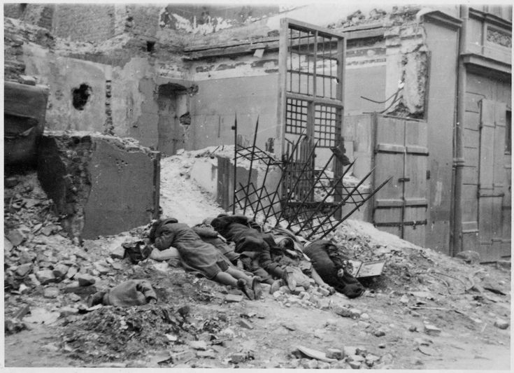 Jewish civilians lie where they fell after being murdered by the Waffen SS during the Warsaw Ghetto Uprising. The photo was included in the notorious Stroop Report, authored by SS-Gruppenführer und Generalleutnant der Waffen-SS und Polizei Jürgen Stroop, who was the commanding officer during the liquidation of the ghetto. Stroop was hanged in Warsaw in 1952.