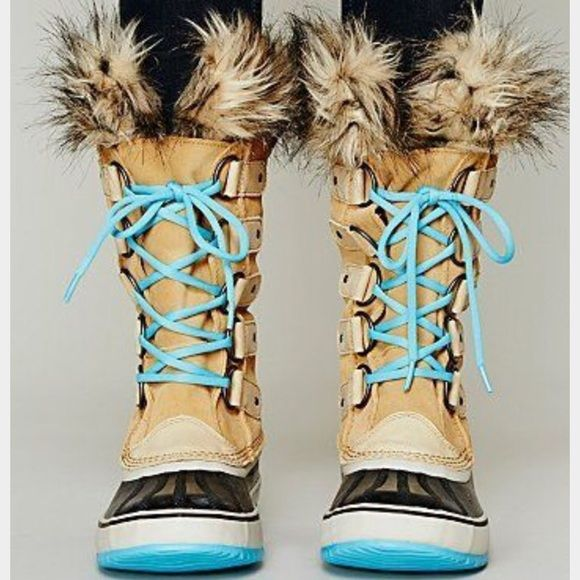 SOREL Winter Boots These SOREL lace up winter boots are tan, ivory, black and Aqua blue! NEVER WORN! Size 10! Super warm! They have faux fur around the top of the boots! SOREL Shoes Winter & Rain Boots