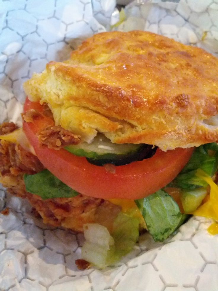 Nashville hot thigh, on a biscuit, romaine, tomato, Wisconsin cheddar, rancho verde (on side).
