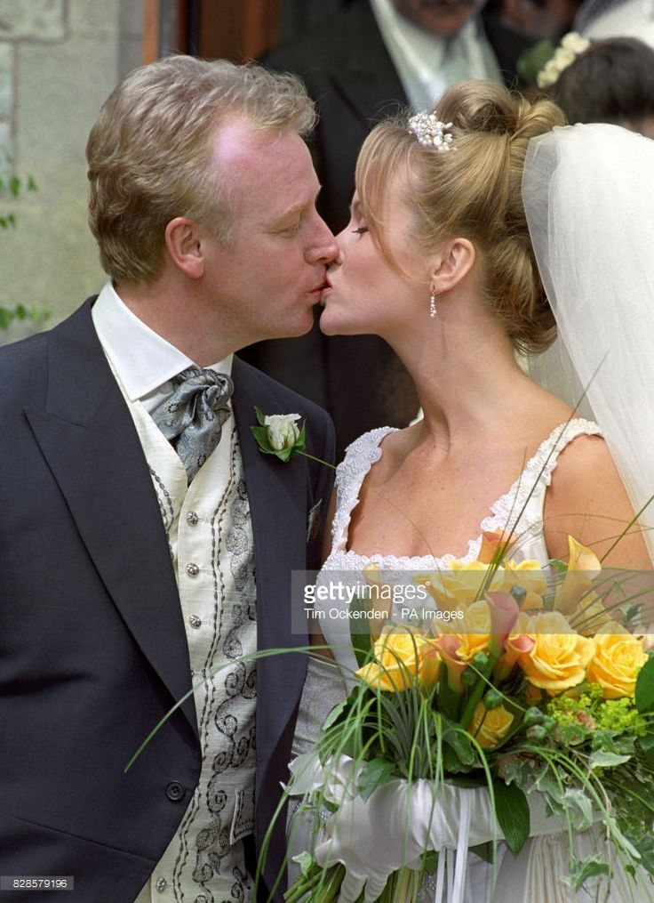 Comedian Les Dennis with his bride, actress Amanda Holden, following their wedding in Bournemouth this afternoon (Sunday).