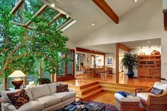 Bring nature into your living space with floor-to-ceiling windows, skylights, and lots of greenery.