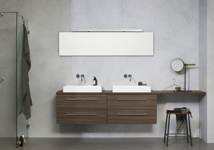 Minimalistic and strictly symmetrical double washbasin – break it up by extending the counter top adding a vanity space on one side only.