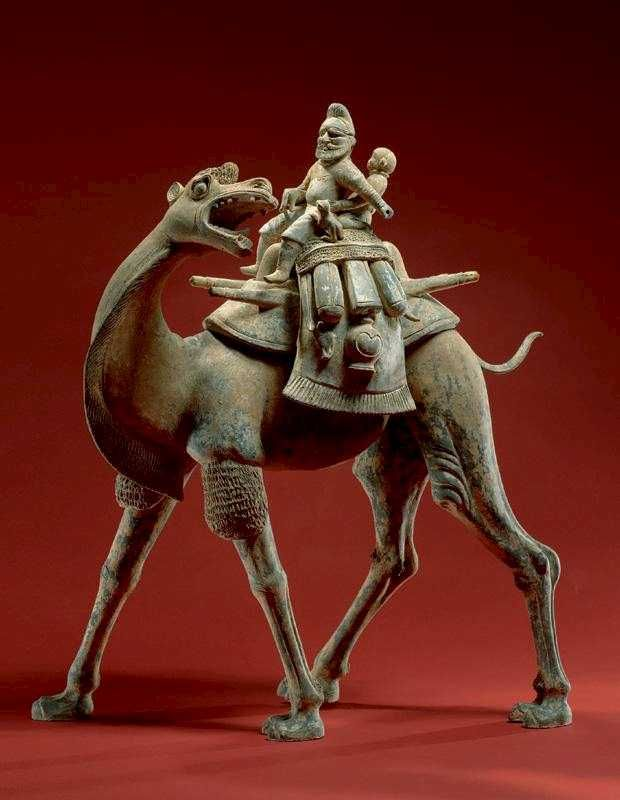 Bactrian Camel Riders and Dogs   Country of Origin: Tan'g China  Date of Origin Tang Dynasty late 8th century. Use: Funeral figure.