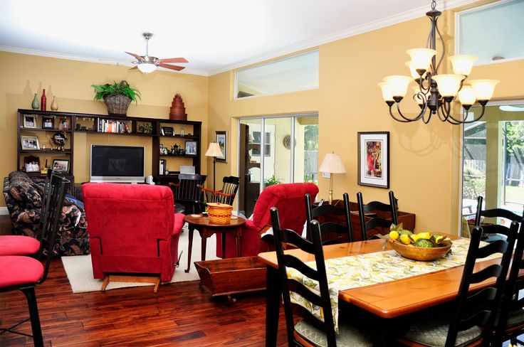 Busy Cozy Homey Living Room Den Dining Kitchen Combo Area Open Layout Red Accents Warm Neutral Walls And Pallet By The Best Custom Construct