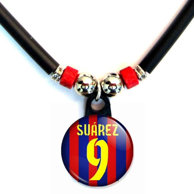 Luiz Suarez FC Barcelona Jersey Necklace. 18 inch rubber cord with lobster claw clasp. 1 inch round Luiz Suarez pendant with number 9. Perfect for Luiz Suarez fans. Perfect for FC Barcelona or Uruguay national team fans. Luiz Suarez Jersey Number 9 Necklace.
