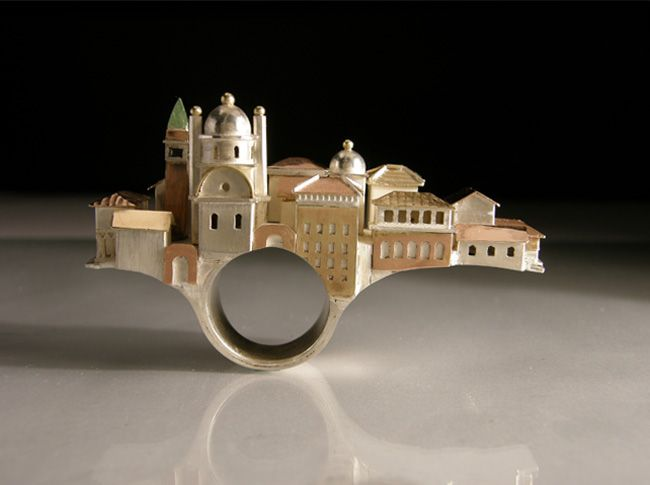 Vicki Ambery-Smith created Venice bridge ring. I like this design because there are a lot of detail and different element. For me is very interesting use architecture. In this project used Photoshop