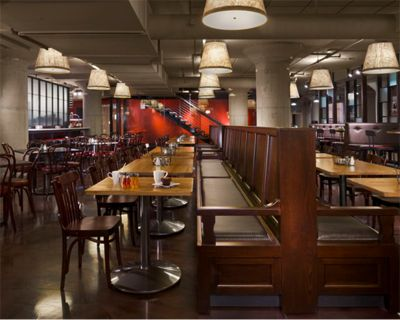 """Sodo Kitchen - Starbucks corporate restaurant. An upholstered banquette helps divide the dining area into """"pockets"""" at Sodo Kitchen, the Starbucks corporate cafe in Seattle."""