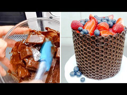 Take melted chocolate and spread on precut bubble wrap. Wrap around cake and let harden. Remove wrap!!